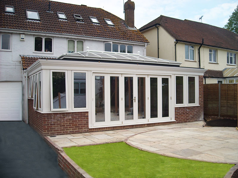 Pvc orangeries with elegant moulded fascia hallmark for Conservatory doors exterior